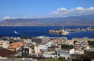 Port of Messina with the gold Madonna della Lettera statue. Sicily. Italy